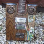 Close up of the custom Bo Diddley style guitar