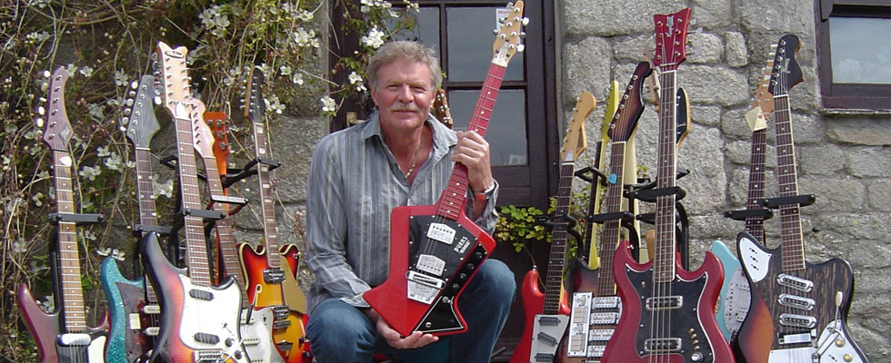 Guy Mackenzie with some of his guitar collection