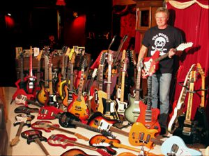 Guy Mackenzie with his guitar collection