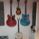 Part of Phil Walker's guitar collection including a banjo